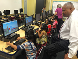 Commissioner Roberts at the computer lab with students.